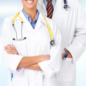 Group of medical doctors over blue hospital background